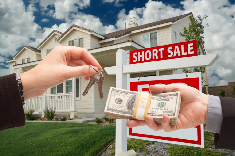 Handing Over Cash For House