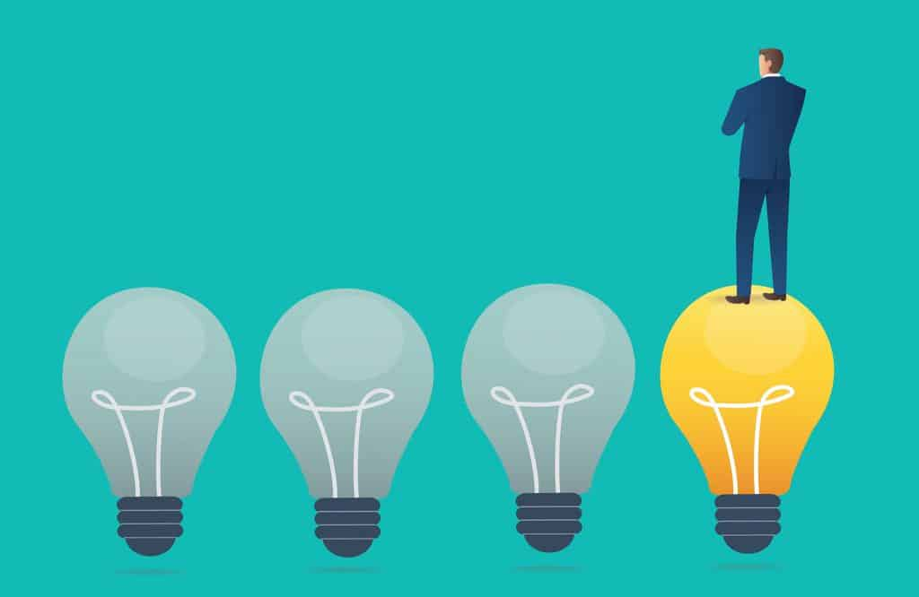 businessman standing on light bulb with blue background creative thinking concept vector illustration scaled