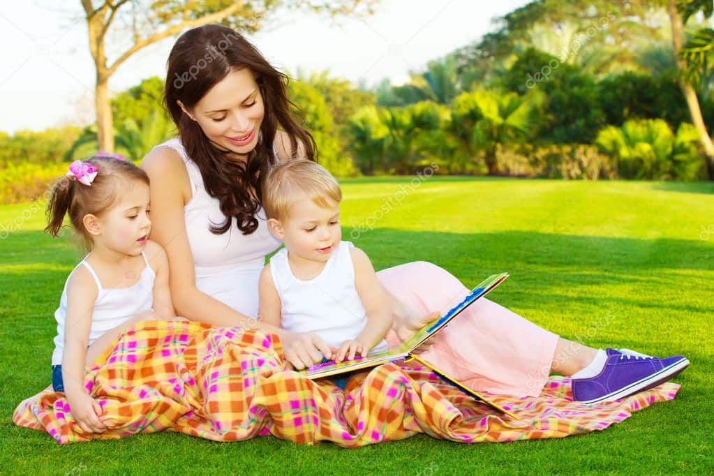 depositphotos  stock photo mother with children read book