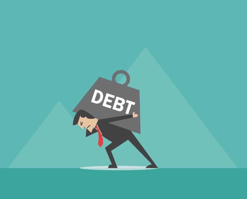 man dealing with heavy debt