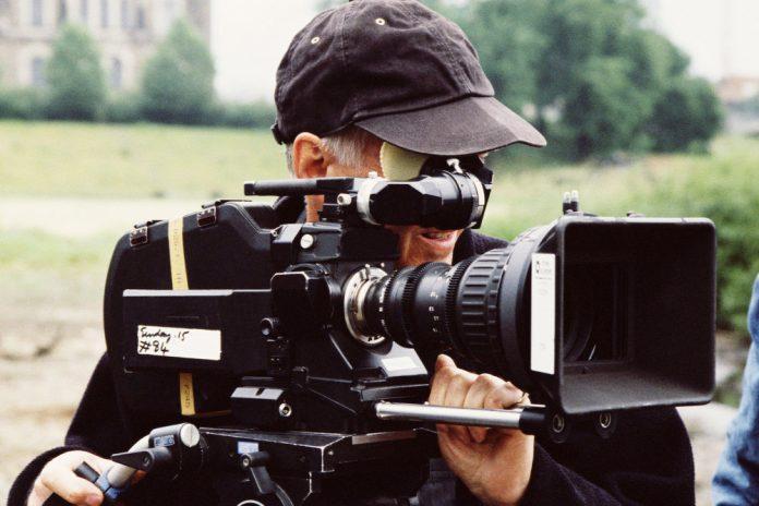 man using large camera AB cfbfecade  e